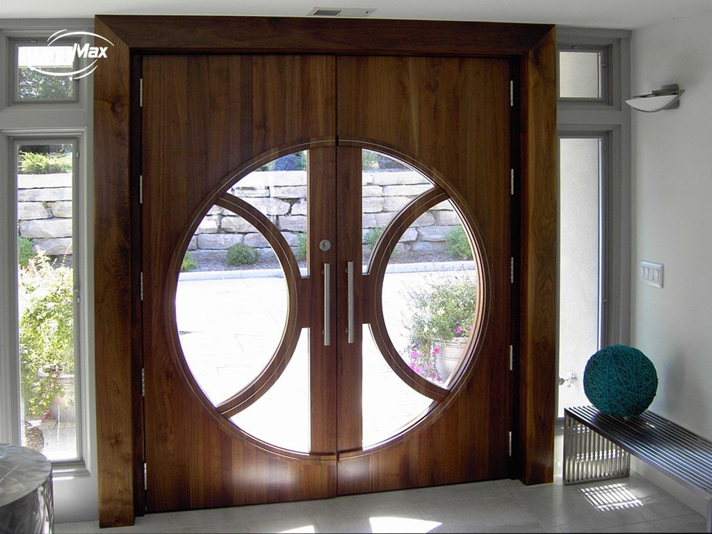 Walnut pair with circular lites and stainless steel accent strips & Custom Door Portfolio Galleries | WoodMax Custom Doors