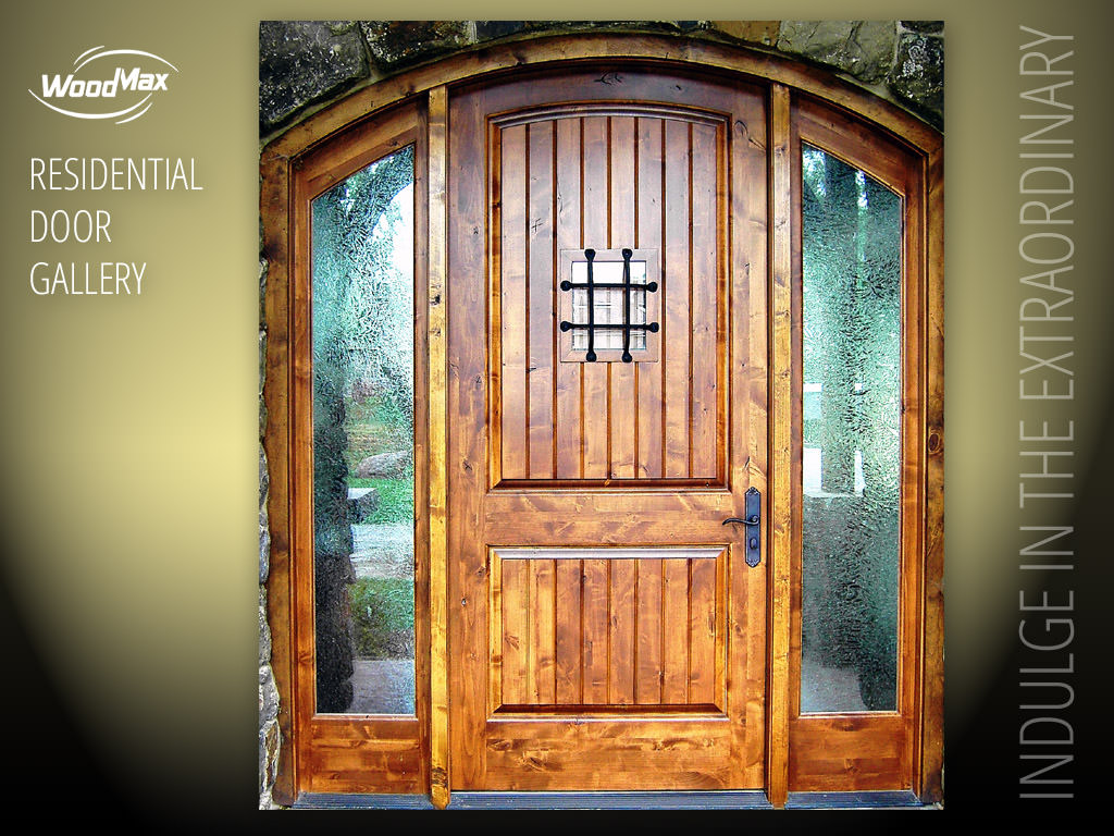 1024 Knotty Alder Arched Entry with plank style panels speakeasy window door and grill and glue chip textured glass in sidelights & Custom Door Portfolio Galleries | WoodMax Custom Doors
