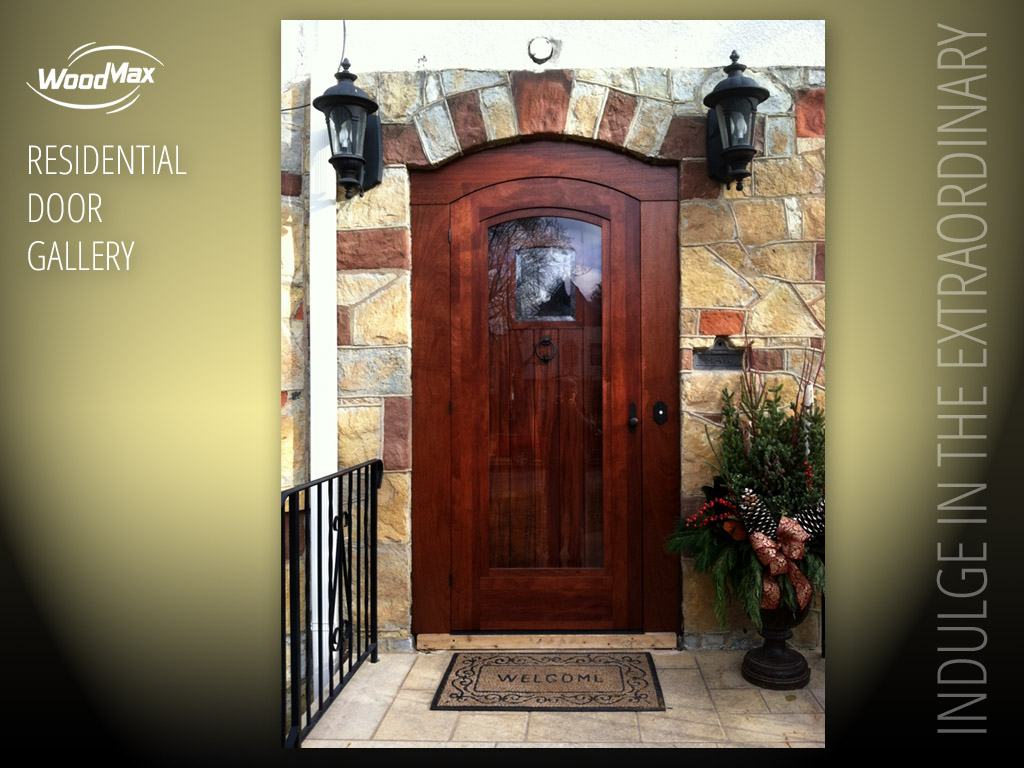 1024: Mahogany Arch Top Entry With Plank Style Panel And Speakeasy Window.  Matching Storm Door.